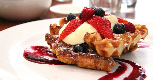 waffles with cointreau laced summer berries, cream & blueberry coulis ...