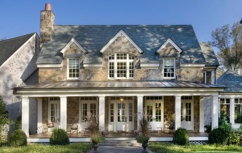 Dream house! Love the front porch and the dormer windows. And the