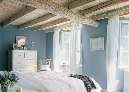 Blue walls, white bedding, and wood beams. beach house !