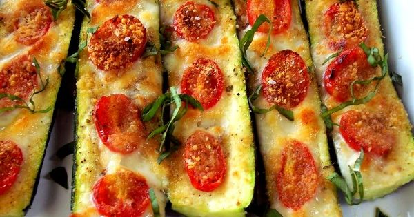 Zucchini boats with Roma tomatoes and basil. Cut a zucchini in half
