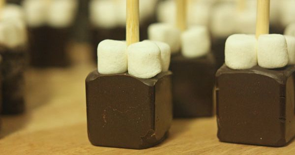 Hot Chocolate on a Stick: Chocolate shavings, cocoa, powdered sugar, mini marshmallows