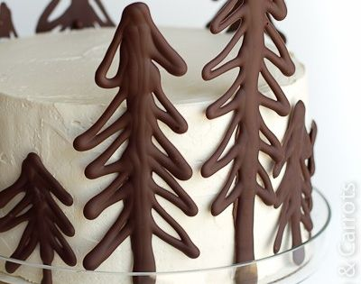 Draw Christmas trees on parchment paper using melted chocolate. Place in frig