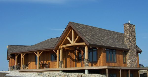 Rustic country homes wood and stone exterior columns for Timber frame house plans with walkout basement