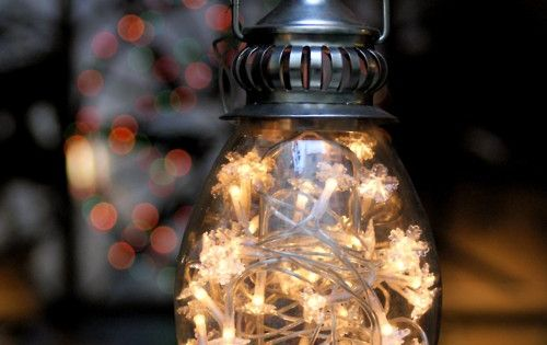 Hang a lantern filled with a strand of twinkle lights. It looks