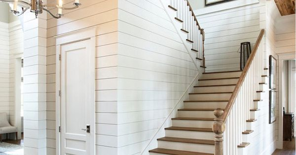 White Shiplap Walls And Reclaimed Wood Ceiling In