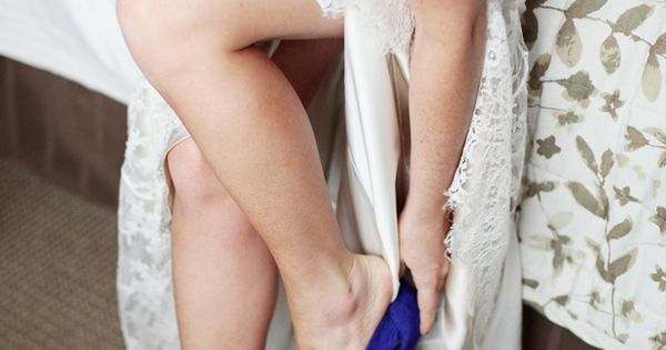Vibrant blue heels add a pop of personality to your wedding outfit!