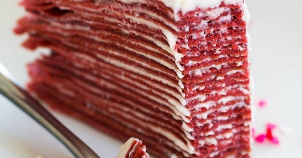 Made with layers of thin red velvet crepes and filled with tangy
