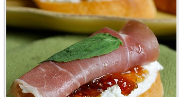 Easy appetizer - Crostini, Goat Cheese, Fig Jam, and Proscuitto. Basil leave