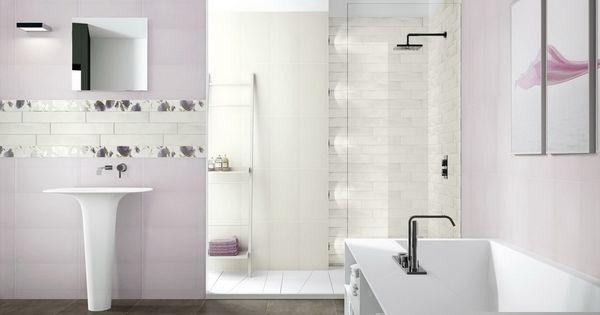An All White Bathroom Using Large Tiles On The Backsplash