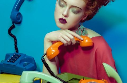 Vogue Italia photograph by Lucia Giacani. Red-head curls, woman with vintage telephones