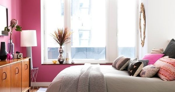 Love the pink accent wall! pink wall gray patterned rug bedroom starburst