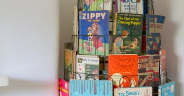 Using an old fashioned panty-hose rack for kids books. Great book display