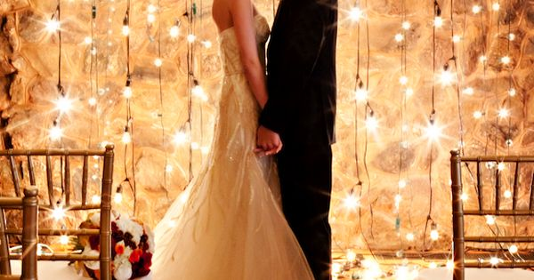 Amazingly gorgeous use of string lighting for a romantic wedding ceremony backdrop!