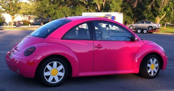 Pink Volkswagen bug. Want!!! But with black racing strips ...
