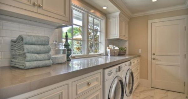 Striking Beach Style Laundry Room Design Interior with White Laundry Room Cabinets