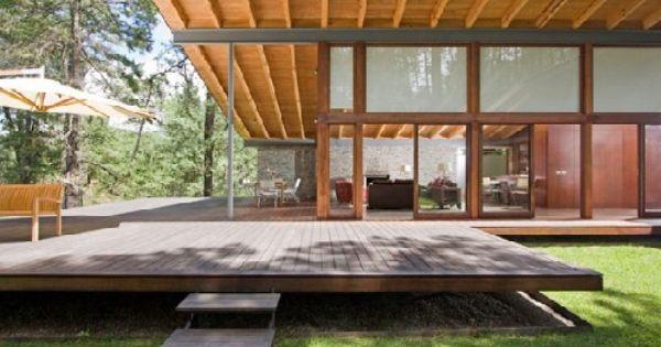 Fachada de casa moderna combinada con fachada de casa de for Casa moderna 7 mirote y blancana