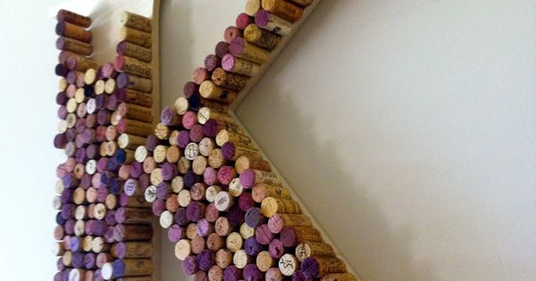 Monogram wall decor made from wine bottle corks. Cool idea