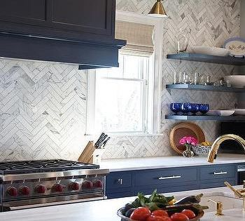 Navy Blue Kitchen Cabinets With Brass Bar Pulls And Marble