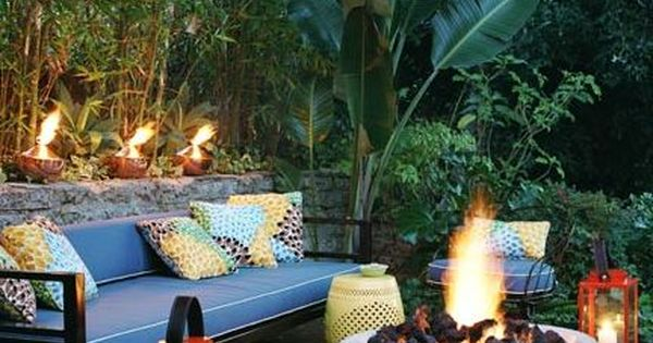 Concrete fire pit and decorative eclectic additions make for a cozy conversation area outdoor - Types fire pits cozy outdoor spaces ...