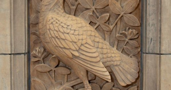 Carving in relief the bird stands out more than