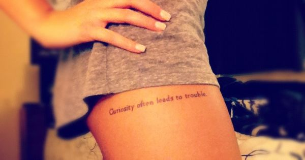 """curiosity often leads to trouble"" thigh tattoo"