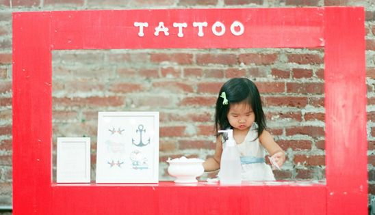 Temporary tattoo parlor! Way cooler than a lemonade stand :) Fun party