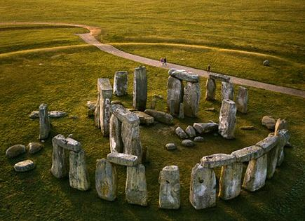 Stonehenge, United Kingdom Located in Wiltshire, England, the Stonehenge is the remains of a ring of standing stones and archaeologists believe that it could have been a burial ground. stonehenge england uk unitedkingdom prehistoric monument green white