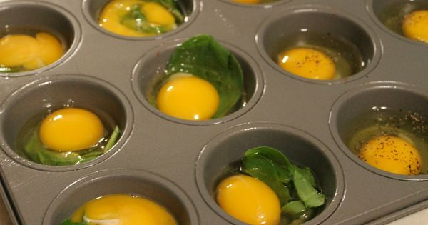 Eggs for breakfast sandwiches - Spray muffin pan with non-stick cooking spray.