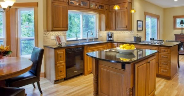 A traditional island shaped kitchen with beech wood for Beech wood kitchen cabinets
