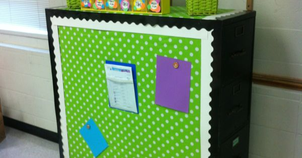 Classroom decor: Two filing cabinets back to back, creating a magnetic bulletin