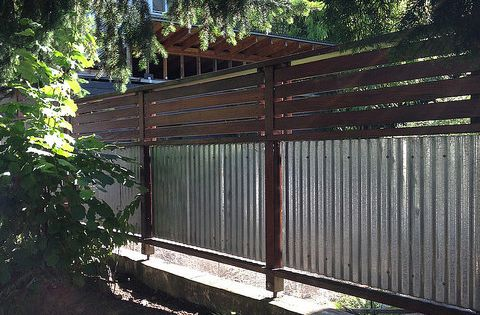 Corrugated Metal And Wood Fence With Horizontal Slats