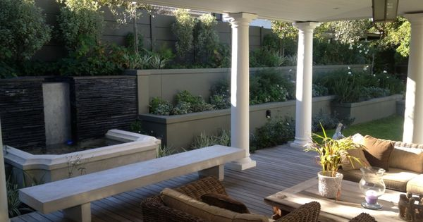 Planters the pond disguise the retaining needed to Relaxed backyard deck ideas