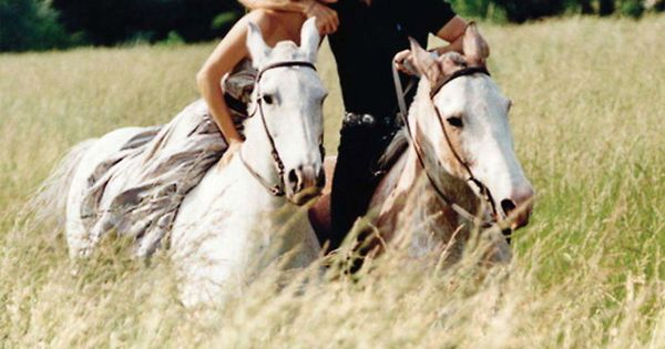 Romantic horseback ride on white horses. RalphLauren