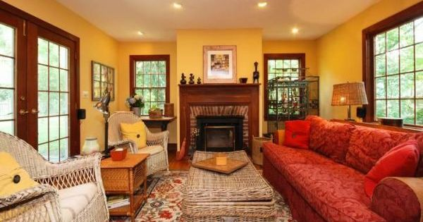 Colonial living room in yellow and red colonial living for Red and yellow living room ideas