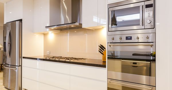 A luxury kitchen with stacked eye level ovens an exhaust for Eye level oven kitchen designs
