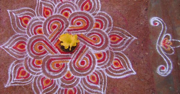 Traditional kolam kolams art work on the floor for Floor rangoli design