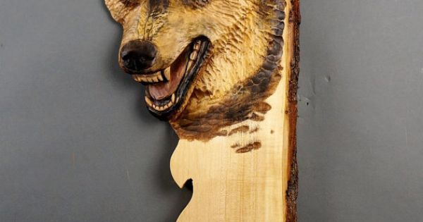 Wolf carved on wood carving linden tree with bark