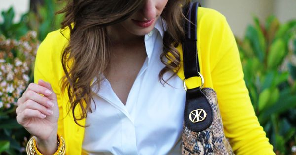 love the snake paired with this bright yellow cardigan