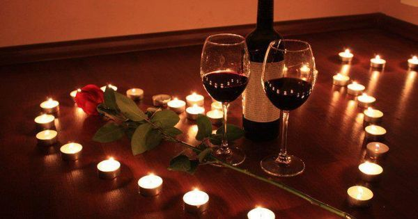 romance romantic setting of two wine glasses and one red rose with lighted candles in a shape on. Black Bedroom Furniture Sets. Home Design Ideas
