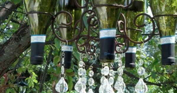 Wine bottle chandelier with solar lights inside our for Diy solar wine bottle lights