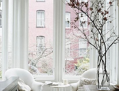 jenna lyons' living room. loving the branches & tall windows