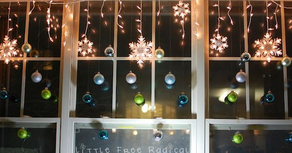 hang ornaments in the window off a strand of christmas. Black Bedroom Furniture Sets. Home Design Ideas
