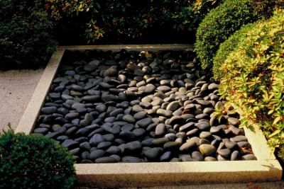 How To Spray Thompson S Water Seal On Landscape Rock Hunker Landscaping With Rocks Stone Landscaping Landscape Rock