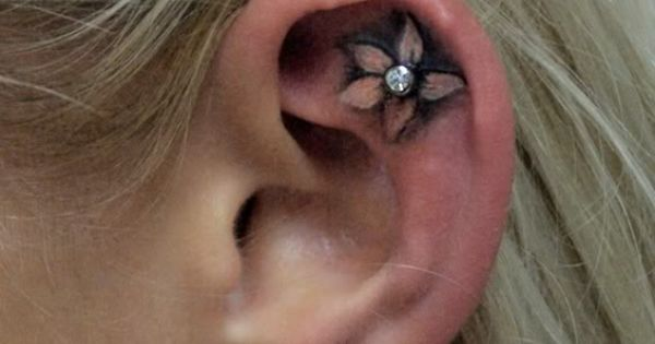 Flower ear tattoo with piercing (cute idea!)