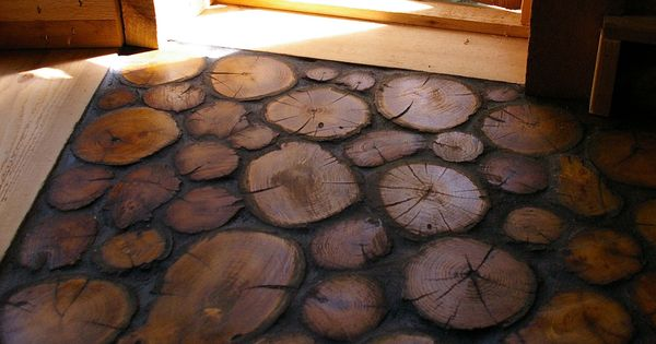 tree stump floor. Fantastic mud room floor idea!