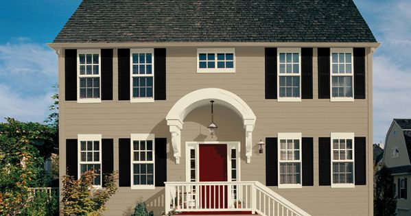 Wall colonial revival stone sw 2827 trim classical white sw 2829 accent tricorn black sw 6258 for Colonial revival stone exterior paint
