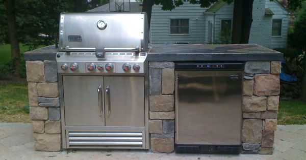 A Very Simple Outdoor Kitchen With A Bbq Grill Sink And