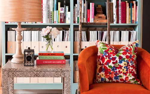 "library: colorful bookshelf, rad orange chair, pretty pillow & ""window box"" coffee"