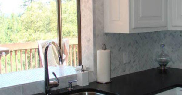 White cabinets black granite herringbone backsplash Home