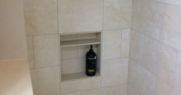 Shower With Accent Border, Niche, And Foot Rest For